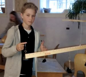 Seventh grader learning the law of the lever